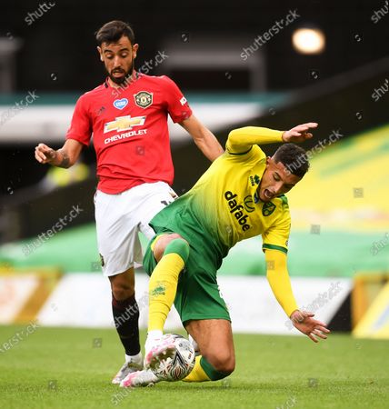 Ben Godfrey (R) of Norwich in action against Bruno Fernandes (L) of Manchester United during the English FA Cup quarter final soccer match between Norwich City and Manchester United in Norwich, Britain, 27 June 2020.