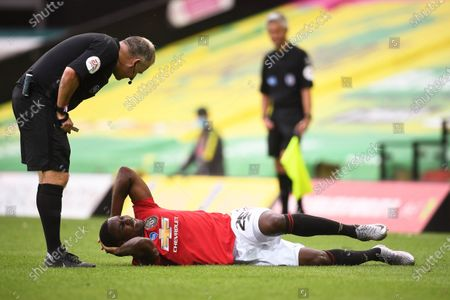 Odion Ighalo (bottom) of Manchester United reacts during the English FA Cup quarter final soccer match between Norwich City and Manchester United in Norwich, Britain, 27 June 2020.