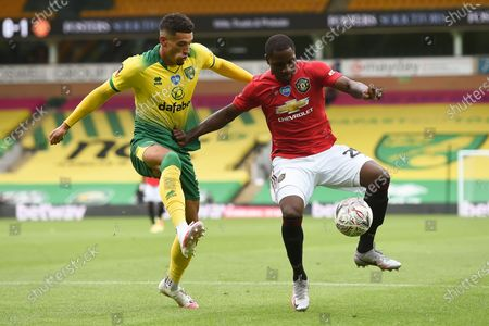 Ben Godfrey (L) of Norwich in action against Odion Ighalo (L) of Manchester United during the English FA Cup quarter final soccer match between Norwich City and Manchester United in Norwich, Britain, 27 June 2020.