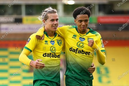Todd Cantwell (L) of Norwich celebrates with teammate Jamal Lewis (R) after scoring the 1-1 equalizer during the English FA Cup quarter final soccer match between Norwich City and Manchester United in Norwich, Britain, 27 June 2020.