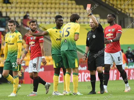 Timm Klose (3-R) of Norwich is sent off by referee Jonathan Moss (2-R) during the English FA Cup quarter final soccer match between Norwich City and Manchester United in Norwich, Britain, 27 June 2020.