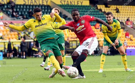 Ben Godfrey (L) of Norwich in action against Odion Ighalo (C) of Manchester United during the English FA Cup quarter final soccer match between Norwich City and Manchester United in Norwich, Britain, 27 June 2020.