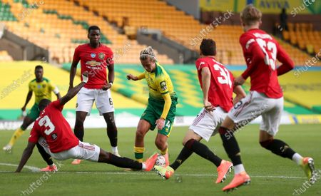 Todd Cantwell (C) of Norwich in action against Eric Bailly (L) of Manchester United during the English FA Cup quarter final soccer match between Norwich City and Manchester United in Norwich, Britain, 27 June 2020.