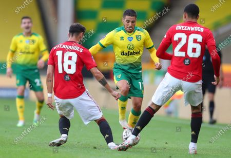 Emi Buendia (C) of Norwich in action against Manchester United players Bruno Fernandes (L) and Mason Greenwood (R) during the English FA Cup quarter final soccer match between Norwich City and Manchester United in Norwich, Britain, 27 June 2020.