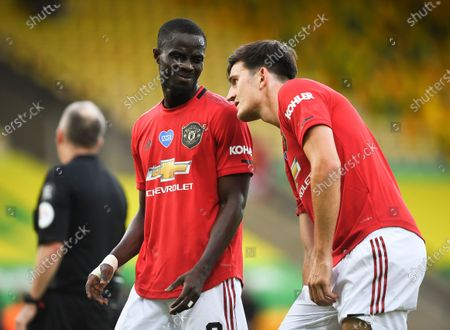 Manchester United players Eric Bailly (C) and Harry Maguire (R) react during the English FA Cup quarter final soccer match between Norwich City and Manchester United in Norwich, Britain, 27 June 2020.
