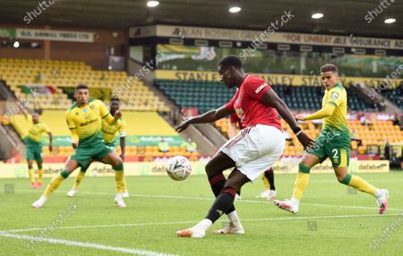 Odion Ighalo (C) of Manchester United in action during the English FA Cup quarter final soccer match between Norwich City and Manchester United in Norwich, Britain, 27 June 2020.