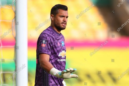 Manchester United goalkeeper Sergio Romero reacts during the English FA Cup quarter final soccer match between Norwich City and Manchester United in Norwich, Britain, 27 June 2020.