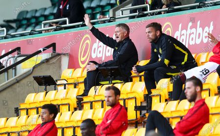 Manchester United manager Ole Gunnar Solskjaer (up L) reacts in the stands during the English FA Cup quarter final soccer match between Norwich City and Manchester United in Norwich, Britain, 27 June 2020.