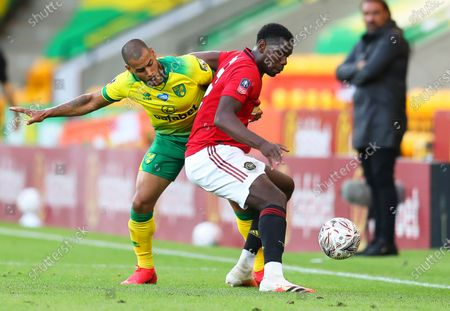 Paul Pogba (C) of Manchester United in action against Onel Hernandez (L) of Norwich during the English FA Cup quarter final soccer match between Norwich City and Manchester United in Norwich, Britain, 27 June 2020.