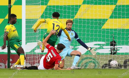 Harry Maguire (bottom) of Manchester United scores the 2-1 lead during the English FA Cup quarter final soccer match between Norwich City and Manchester United in Norwich, Britain, 27 June 2020.