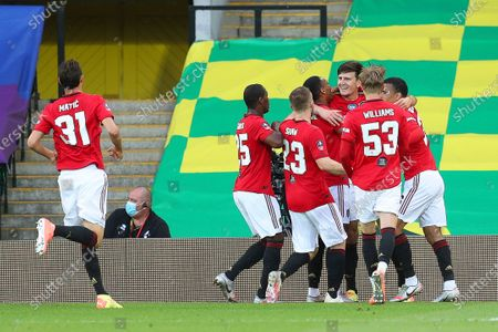 Harry Maguire (3-R) of Manchester United  celebrates with teammates after scoring the 2-1 lead during the English FA Cup quarter final soccer match between Norwich City and Manchester United in Norwich, Britain, 27 June 2020.
