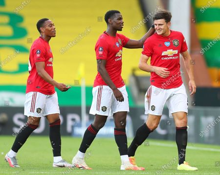 Harry Maguire (R) of Manchester United  celebrates with teammate Paul Pogba (C) after scoring the 2-1 lead during the English FA Cup quarter final soccer match between Norwich City and Manchester United in Norwich, Britain, 27 June 2020.