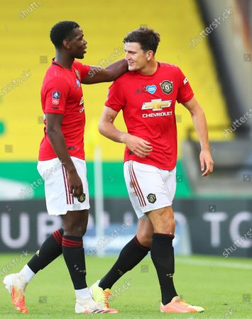 Harry Maguire (R) of Manchester United  celebrates with teammate Paul Pogba (L) after scoring the 2-1 lead during the English FA Cup quarter final soccer match between Norwich City and Manchester United in Norwich, Britain, 27 June 2020.