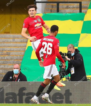 Harry Maguire (up) of Manchester United  celebrates after scoring the 2-1 lead during the English FA Cup quarter final soccer match between Norwich City and Manchester United in Norwich, Britain, 27 June 2020.