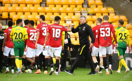 Manchester United's manager Ole Gunnar Solskjaer (C-R) celebrates with his players after winning the English FA Cup quarter final soccer match between Norwich City and Manchester United in Norwich, Britain, 27 June 2020.