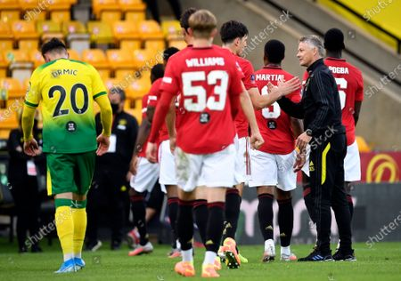 Manchester United's manager Ole Gunnar Solskjaer (R) celebrates with his players after winning the English FA Cup quarter final soccer match between Norwich City and Manchester United in Norwich, Britain, 27 June 2020.