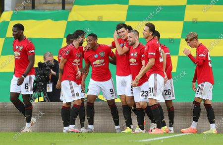 Harry Maguire (C) of Manchester United celebrates with teammates after scoring the 2-1 lead during the English FA Cup quarter final soccer match between Norwich City and Manchester United in Norwich, Britain, 27 June 2020.