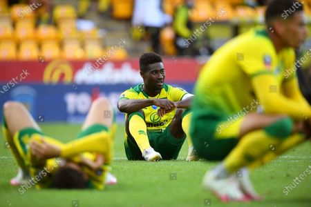 Norwich players show their dejection after the English FA Cup quarter final soccer match between Norwich City and Manchester United in Norwich, Britain, 27 June 2020.