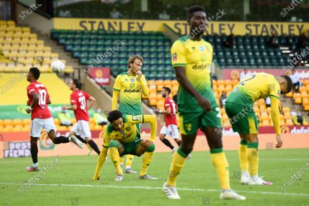 Norwich players react during the English FA Cup quarter final soccer match between Norwich City and Manchester United in Norwich, Britain, 27 June 2020.