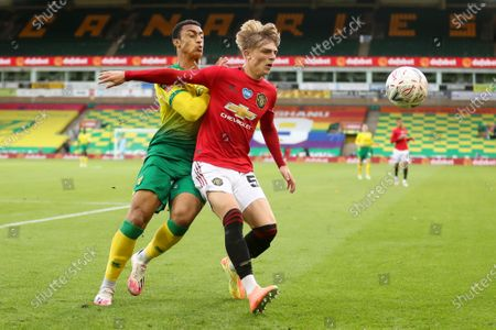 Brandon Williams (R) of Manchester United in action against Adam Idah (L) of Norwich during the English FA Cup quarter final soccer match between Norwich City and Manchester United in Norwich, Britain, 27 June 2020.
