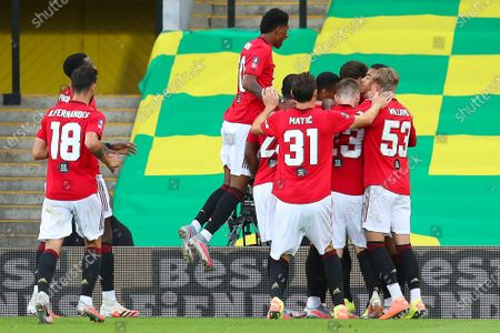 Manchester United players celebrate their 2-1 lead during the English FA Cup quarter final soccer match between Norwich City and Manchester United in Norwich, Britain, 27 June 2020.