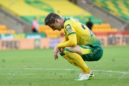Kenny McLean of Norwich shows his dejection after the English FA Cup quarter final soccer match between Norwich City and Manchester United in Norwich, Britain, 27 June 2020.