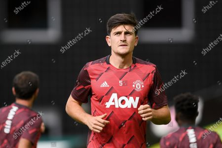 Harry Maguire of Manchester United warms up prior to the English FA Cup quarter final soccer match between Norwich City and Manchester United in Norwich, Britain, 27 June 2020.