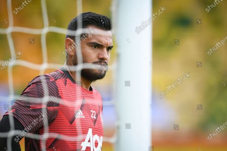 Manchester United goalkeeper Sergio Romero warms up prior to the English FA Cup quarter final soccer match between Norwich City and Manchester United in Norwich, Britain, 27 June 2020.