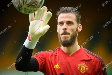 Manchester United goalkeeper David de Gea warms up prior to the English FA Cup quarter final soccer match between Norwich City and Manchester United in Norwich, Britain, 27 June 2020.
