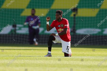 Fred of Manchester United takes a knee in solidarity with the Black Lives Matter movement prior to the English FA Cup quarter final soccer match between Norwich City and Manchester United in Norwich, Britain, 27 June 2020.