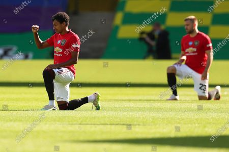 Jesse Lingard (L) of Manchester United takes a knee in solidarity with the Black Lives Matter movement prior to the English FA Cup quarter final soccer match between Norwich City and Manchester United in Norwich, Britain, 27 June 2020.
