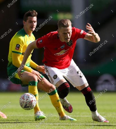 Scott McTominay (R) in action against Kenny McLean (L) of Norwich during the English FA Cup quarter final soccer match between Norwich City and Manchester United in Norwich, Britain, 27 June 2020.