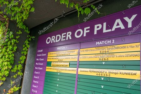 FREE FOR EDITORIAL USE ON BEHALF OF THE AELTC. View of the last year's winning Order of Play board still on the outside of Centre Court at the All England Lawn Tennis Club on a stormy Saturday 27th June 2020 the weekend before The Championships were due to start on Monday 29th June 2020. The grounds are quiet and still, normally they would be busy and bustling with players practising and groundsmen and staff making the final detailed preparations.  The Championships have been cancelled due to the Coronavirus pandemic. Photo: AELTC/Bob Martin