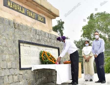 Stock Photo of Deputy Commissioner Shivdular Singh Dhillon paying his tribute to Maharaja Ranjit Singh on his death anniversary at his memorial, in Ram Bagh garden, on June 27, 2020 in Amritsar, Punjab, India. Maharaja Ranjit Singh was the leader of the Sikh Empire, which ruled the northwest Indian subcontinent in the early half of the 19th century. He survived smallpox in infancy but lost sight in his left eye. He was born in Gujranwala (now in Pakistan) on November 13, 1780, and died on June 27, 1839, in Lahore.