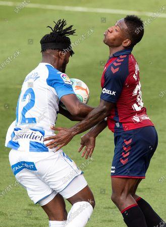 Osasuna's Pervis Estupinan (R) in action against Leganes' Chidozie Awaziem (L) during the Spanish La Liga soccer match between CA Osasuna and CD Leganes at El Sadar Stadium in Pamplona, northern Spain, 27 June 2020.