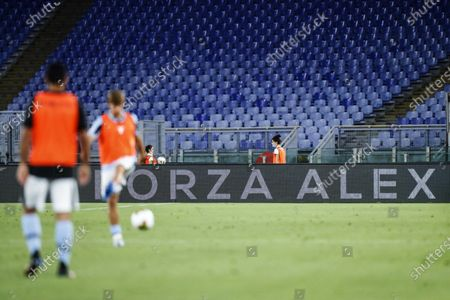 A message of encouragement for Italian racing driver Alex Zanardi - who is currently in a medically-induced coma following a road accident with his handbike - is displayed during the Italian Serie A soccer match between SS Lazio and ACF Fiorentina at the Stadio Olimpico in Rome, Italy, 27 June 2020.