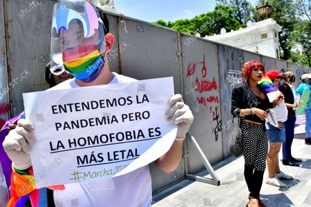 A person with a sign that reads 'we understand the pandemic but homophobia kills more' from the LGBT community march in Mexico City, Mexico, 27 June 2020. Complemented by a virtual march, Mexico celebrates Pride this Saturday, a commemoration to which more and more brands are added. Cesar Casas, president of the Federation of LGBT Entrepreneurs (FME-LGBT), noting that discrimination costs the national economy $ 80 billion, the Mexican Federation of LGBT Entrepreneurs (FME-LGBT) seeks to allow the country to take advantage of the opportunity that represents diversity as a labor and consumer force.