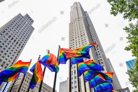 In celebration of Pride, more than 100 colorful rainbow flags line up at the Rink at Rockefeller Center. Consider the COVID-19 coronavirus pandemic as a cause for the region to receive this year's protective mask and pride march that it had or canceled due to health problems. The annual event, which receives millions of participants, marks its 50th anniversary since the first march after the disturbances at the Stonewall Inn.