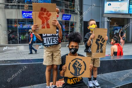 Protesters perform a Black Lives Matter act with LGBTQIA + pride corps in Times Square