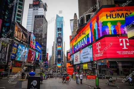The billboards light up with the message 'All Black Lives Matter' and a Pride flag in Times Square. Due to the ongoing COVID-19 coronavirus pandemic, this year's pride march had to be canceled due to health problems. The annual event, which receives millions of attendees, marks its 50th anniversary since the first march following the disturbances at the Stonewall Inn