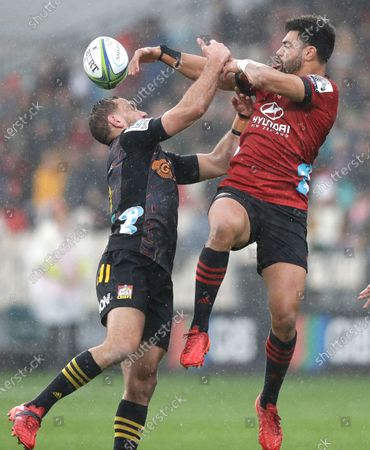 Stock Photo of Crusaders Richie Mo'unga, right, and Chiefs Aaron Cruden compete for the ball during the Super Rugby Aotearoa rugby game between the Crusaders and Chiefs in Christchurch, New Zealand