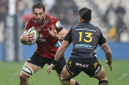 Crusaders Samuel Whitelock runs at Chiefs Quinn Tupaea during the Super Rugby Aotearoa rugby game between the Crusaders and Chiefs in Christchurch, New Zealand