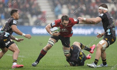 Crusaders Samuel Whitelock runs at the defense during the Super Rugby Aotearoa rugby game between the Crusaders and Chiefs in Christchurch, New Zealand