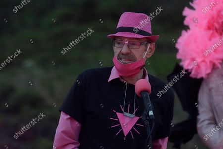 Stock Picture of Patrick Carney, founder of the Pink Triangle, speaks during a ceremony to light LED lights shaped in the formation of a pink triangle atop Twin Peaks during the coronavirus outbreak in San Francisco