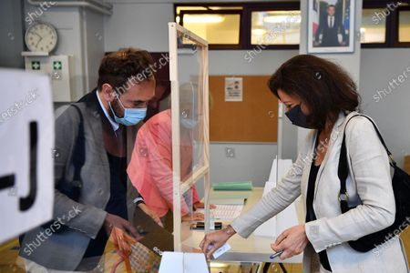 Agnes Buzyn (R), La Republique en Marche (LREM) candidate in the 2020 mayoral elections casts her vote in the second round of the mayoral elections, in the 5th district of Paris, France, 28 June 2020. The second round of municipal elections was to be held on 22 March 2020 but was delayed due to the spread of the coronavirus pandemic causing the Covid-19 disease.