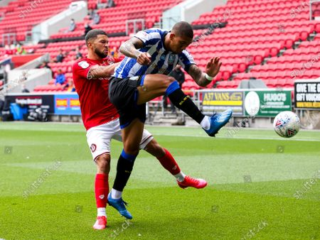 Liam Palmer of Sheffield Wednesday is challenged by Nahki Wells of Bristol City
