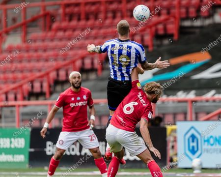 Connor Wickham of Sheffield Wednesday goes up for the ball as Bristol City defender Nathan Baker is underneath him during the EFL Sky Bet Championship match between Bristol City and Sheffield Wednesday at Ashton Gate, Bristol