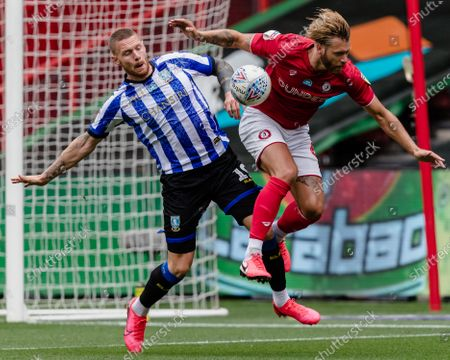 Connor Wickham of Sheffield Wednesday & Bristol City defender Nathan Baker both go for the same ball in the box during the EFL Sky Bet Championship match between Bristol City and Sheffield Wednesday at Ashton Gate, Bristol