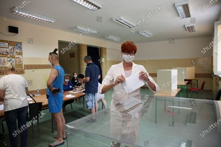 Stock Image of Member of the European Parliament Elzbieta Rafalska (R) vote at a polling station during Poland's presidential elections in Gorzow Wielkopolski, Poland, 28 June 2020. Poles are voting to elect their president for a five-year term. The vote had been due to take place on 10 May but was delayed by the COVID-19 pandemic. Polling stations are open in Poland from 7 a.m. to 9 p.m. If none of the eleven contenders in the race wins more than 50 percent of the vote, under Polish election rules, a second round will be held on 12 July.
