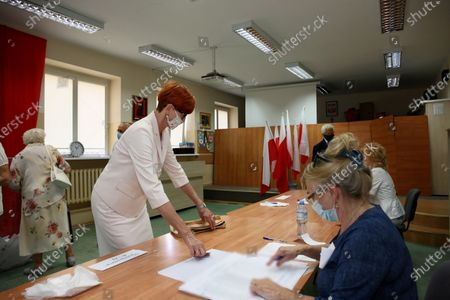 Member of the European Parliament Elzbieta Rafalska (L) vote at a polling station during Poland's presidential elections in Gorzow Wielkopolski, Poland, 28 June 2020. Poles are voting to elect their president for a five-year term. The vote had been due to take place on 10 May but was delayed by the COVID-19 pandemic. Polling stations are open in Poland from 7 a.m. to 9 p.m. If none of the eleven contenders in the race wins more than 50 percent of the vote, under Polish election rules, a second round will be held on 12 July.